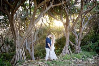 engaged couple at fingal head headland