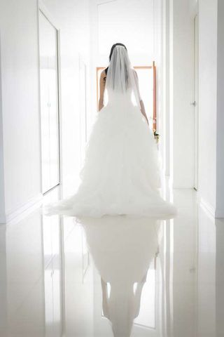 bride portrait of dress with reflection